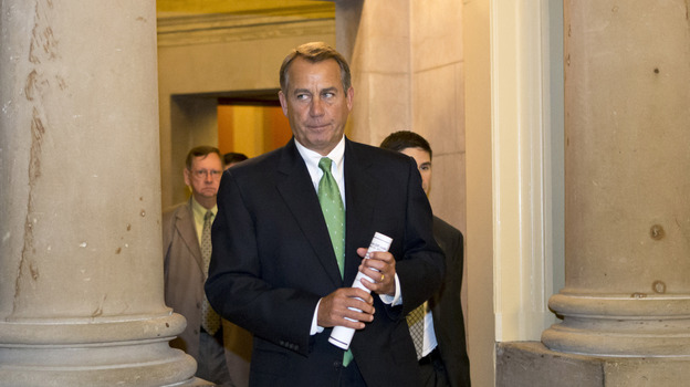 Speaker John Boehner leaves his office Tuesday and walks to the House floor to deliver remarks about negotiations with President Obama on the fiscal cliff. (AP)