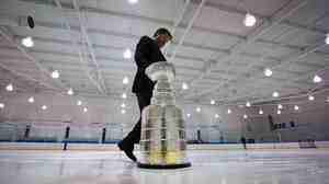 Mike Bolt, keeper of the Stanley Cup, takes it off the ice on Dec. 7, 2012, in Vancouver, British Columbia. The NHL lockout enters its 88th day on Wednesday.