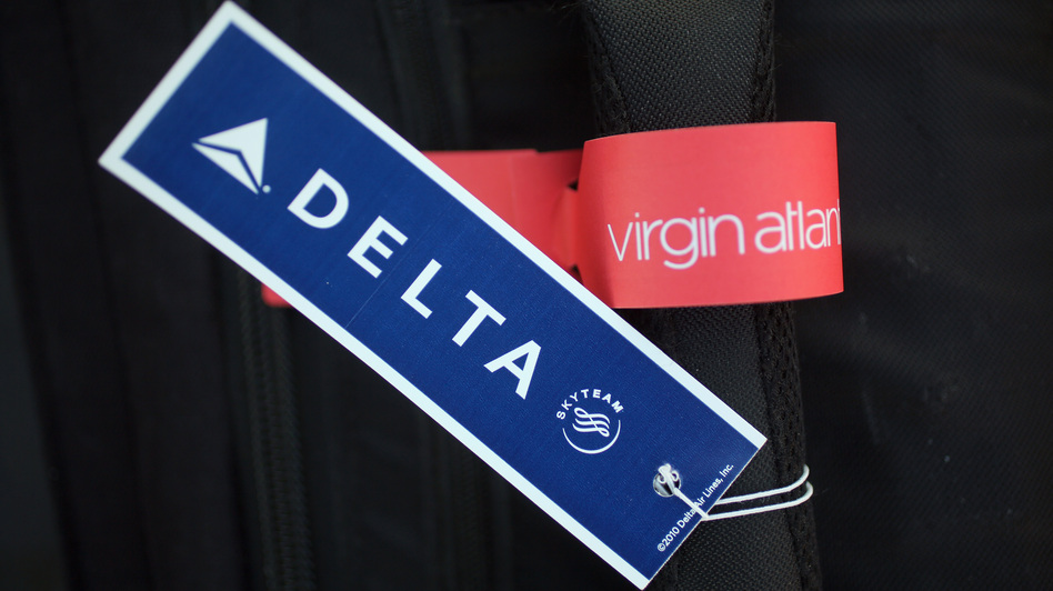 Two bag tags that may soon be together a lot. (Getty Images)
