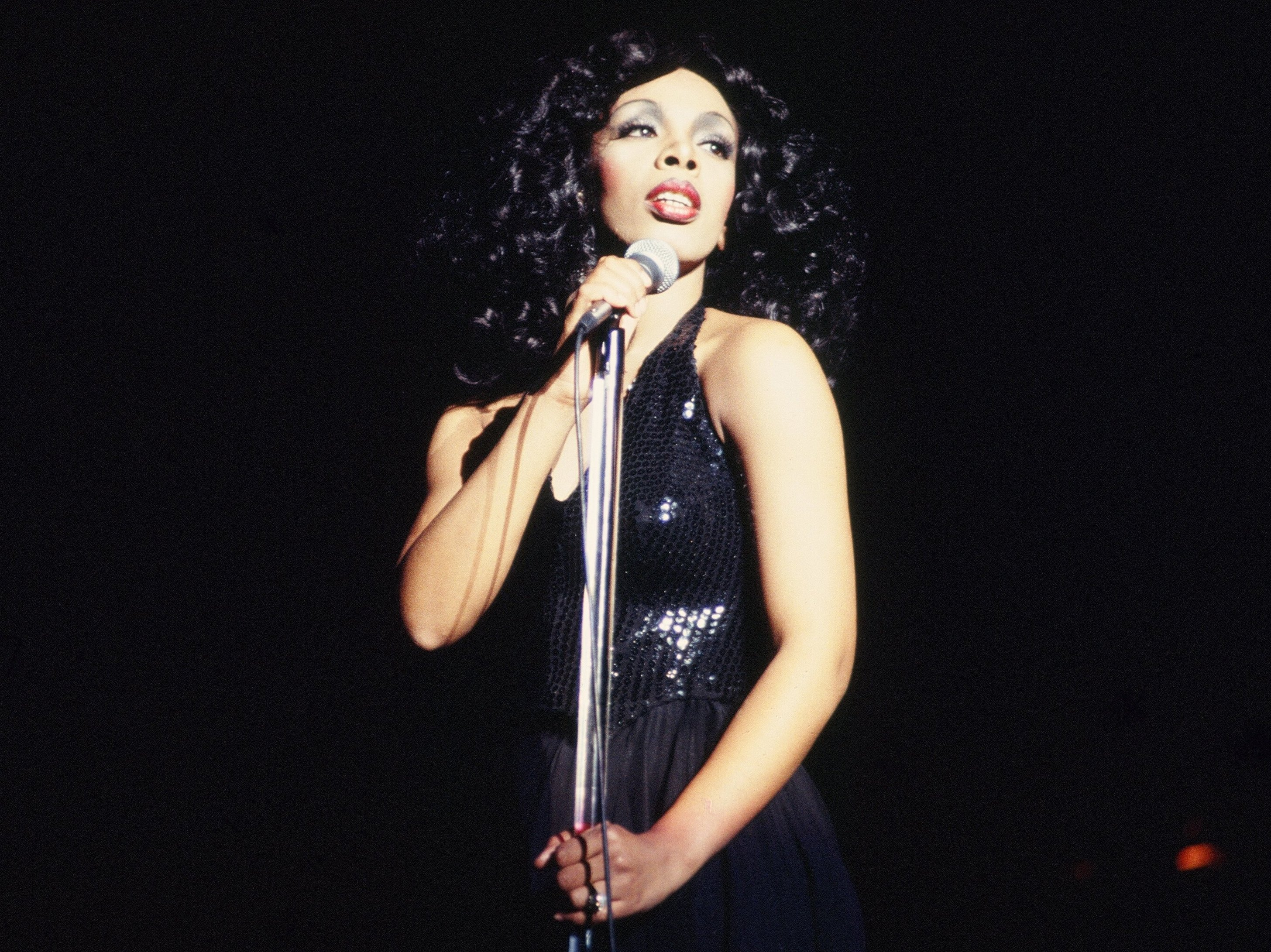 'Queen of Disco' Donna Summer performs onstage at the Civic Center on March 26, 1978 in Atlanta, Georgia.