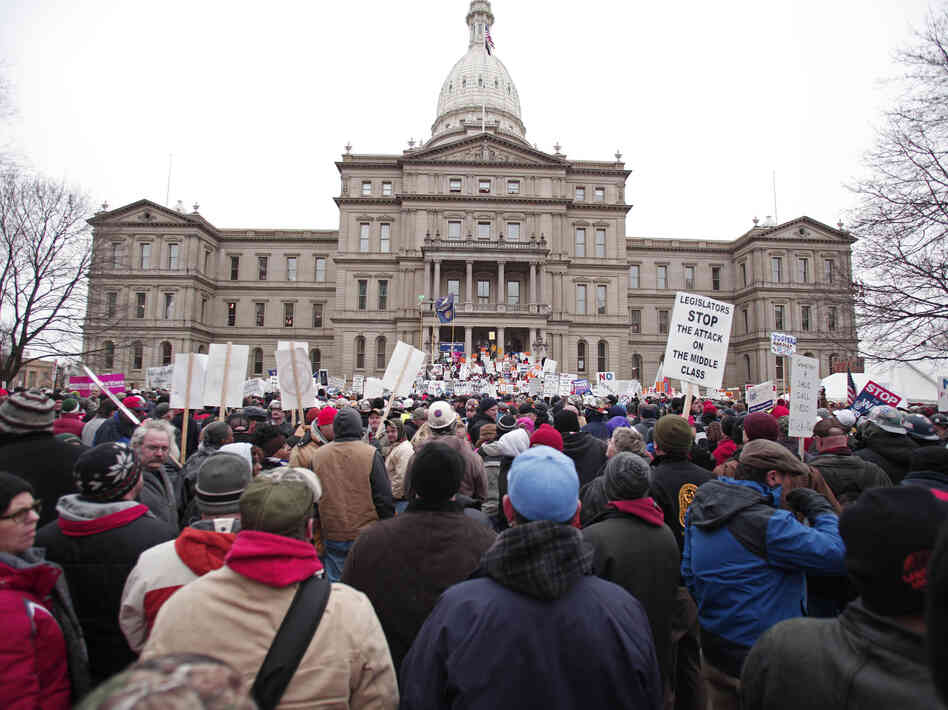 Union members from around the country rallied outside the  Michigan State Capitol in Lansing as lawmakers voted on the right-to-work legislation.