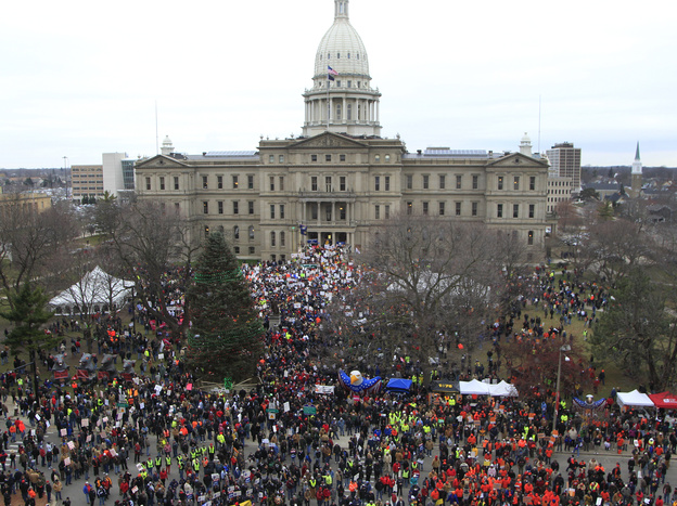 Thousands rally at the state capitol grounds in Lansing, Mich., on Tuesday. The crowd is protesting right-to-work legislation.