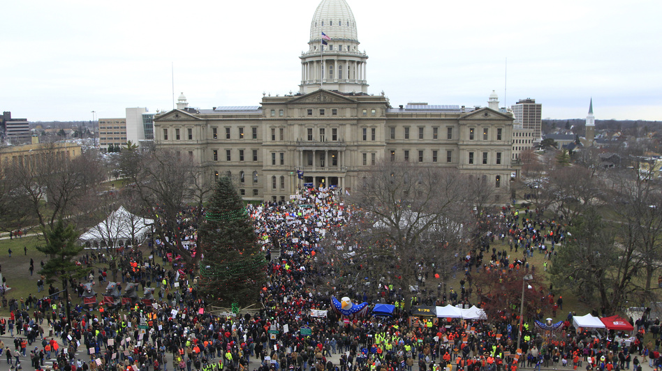 Thousands rally at the state capitol grounds in Lansing, Mich., on Tuesday. The crowd is protesting right-to-work legislation. (AP)
