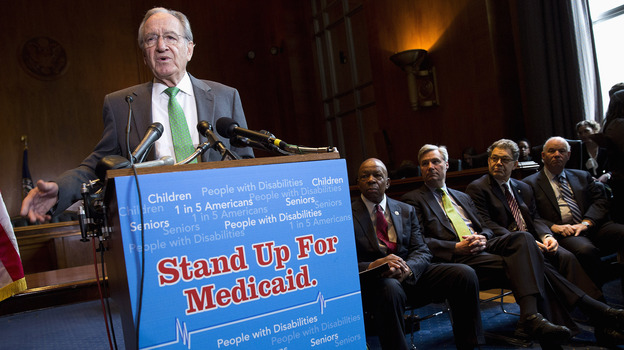Sen. Tom Harkin, D-Iowa, speaks Tuesday as Rep. Elijah Cummings, D-Md., Sen. Sheldon Whitehouse, D-R.I., Sen. Al Franken, D-Minn., and Sen. Ben Cardin, D-Md., listen during a news conference on Capitol Hill calling for no reduction in the Medicare and Medicaid budgets as part of the year-end budget talks. (Reuters /Landov)