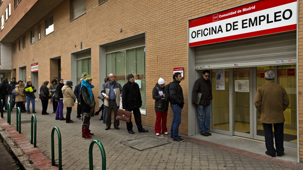 People queue up at a government job center in Madrid this month. The unemployment rate in Spain now tops 25 percent, but many government workers still enjoy job security and higher wages than their private sector counterparts. (AP)