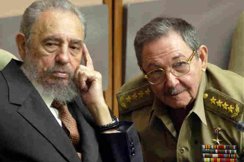 Castro and his brother, Minister of Defense Raul Castro, attend a Cuban Parliament session on July 1, 2004, in Havana. In 2006, Fidel Castro ceded power to his brother due to poor health.