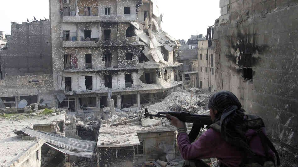 The Syrian military fired Scud missiles on rebel positions in northern Syria this week, a Pentagon source says. Here, a rebel fighter takes a position last month in the northern city of Aleppo, the scene of heavy fighting in