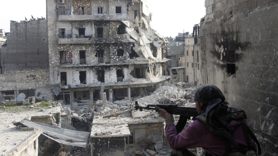 The Syrian military fired Scud missiles on rebel positions in northern Syria this week, a Pentagon source says. Here, a rebel fighter takes a position last month in the northern city of Aleppo, the scene of heavy fighting in recent months. (AP)