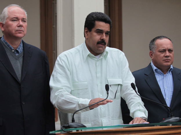Venezuelan Vice President Nicolas Maduro, center, addresses the nation flanked by Oil Minister Rafael Ramirez, left, and National Assembly President Diosdado Cabello at the Miraflores presidential palace in Caracas, Venezuela, on Wednesday.