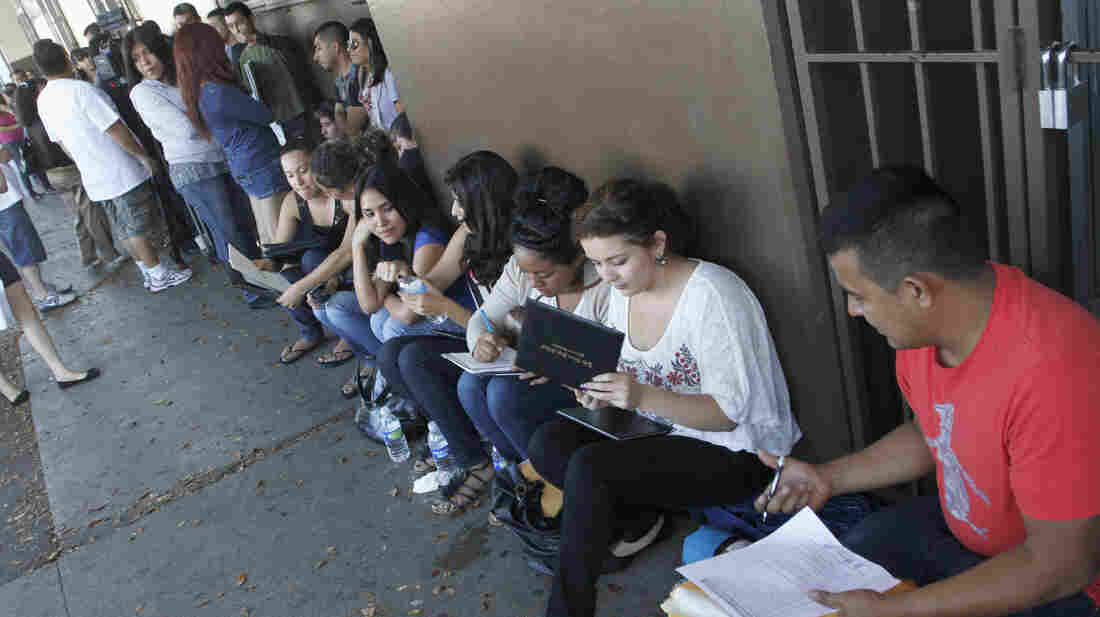 A crowd seeks help applying for the Deferred Action for Childhood Arrivals program at the Coalition for Humane Immigrant Rights of Los Angeles in August. Schools have been inundated with requests for the documents needed to qualify.