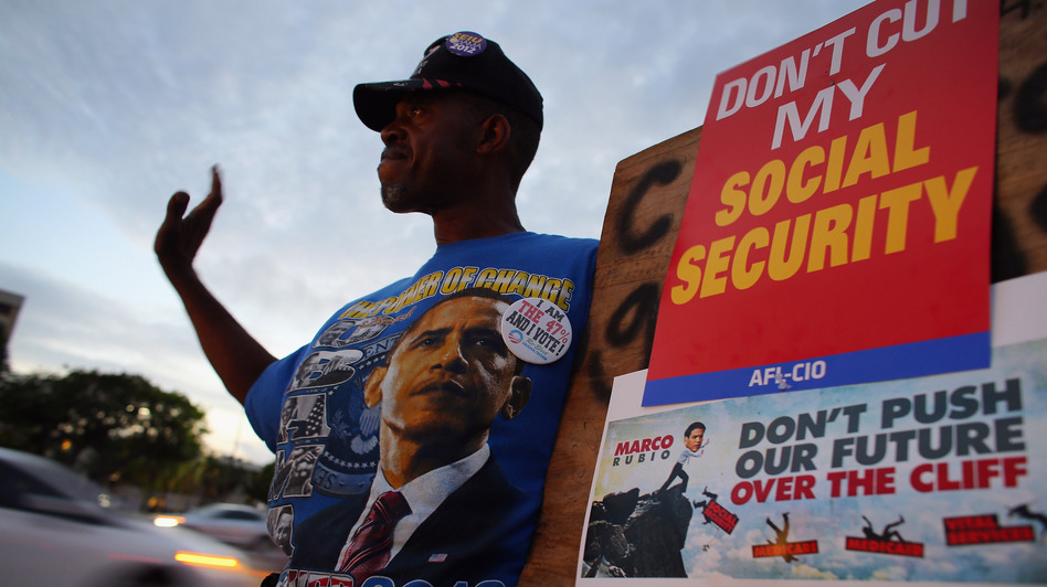 A protester at a fiscal cliff rally on Monday in Doral, Fla. (Getty Images)