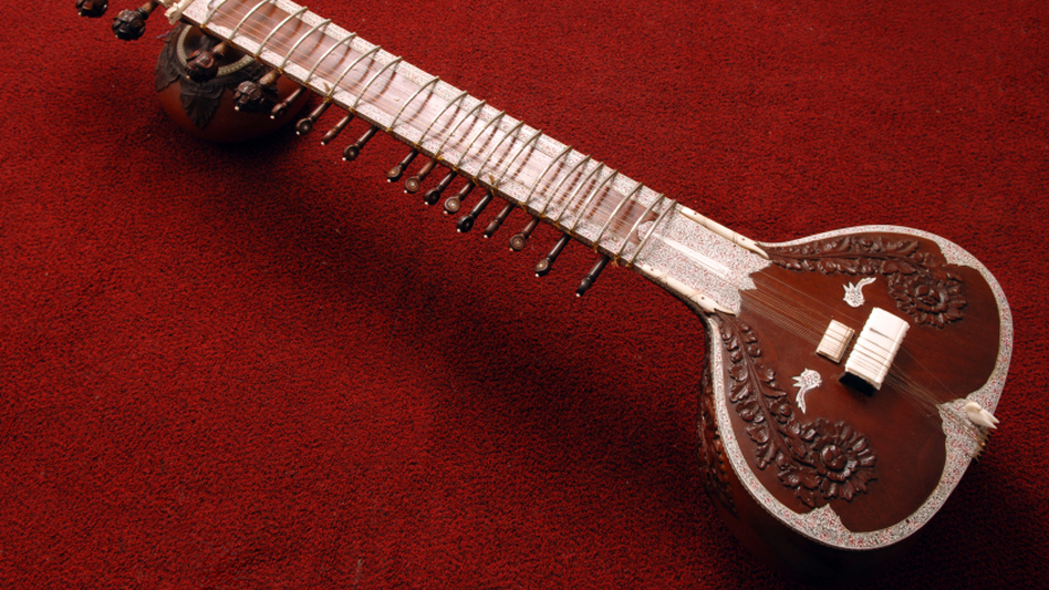 Traditional Indian string instrument, wood and ivory inlay.