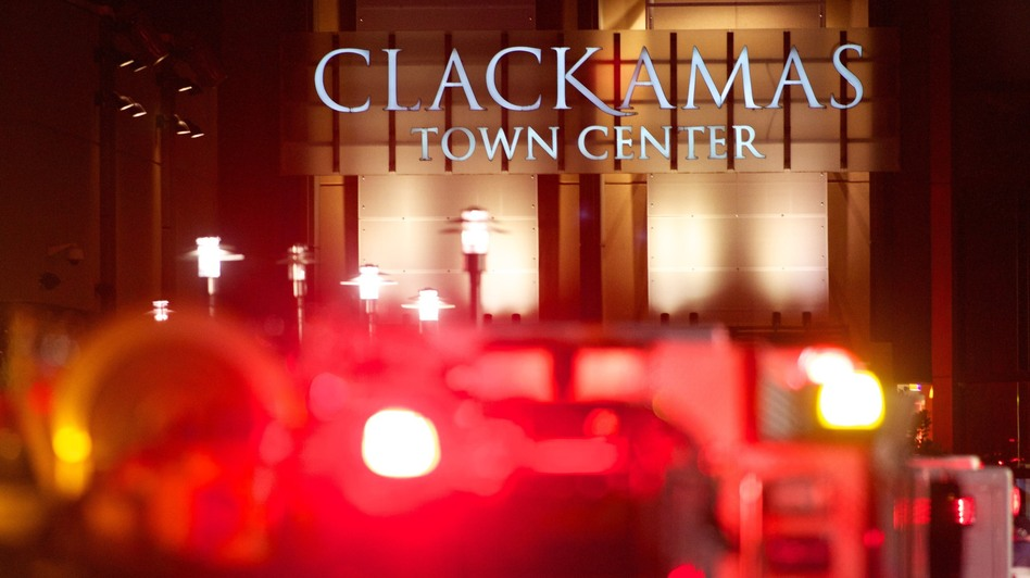 The lights of emergency vehicles illuminated the night Tuesday at the Clackamas Town Center mall just outside Portland. (Getty Images)