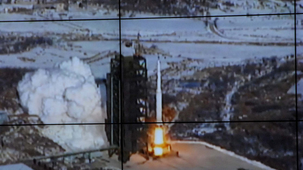 This image from North Korea's official Korean Central News Agency shows the long-range rocket Unha-3 as seen at a satellite control center prior to Wednesday's successful launch. (AFP/Getty Images)