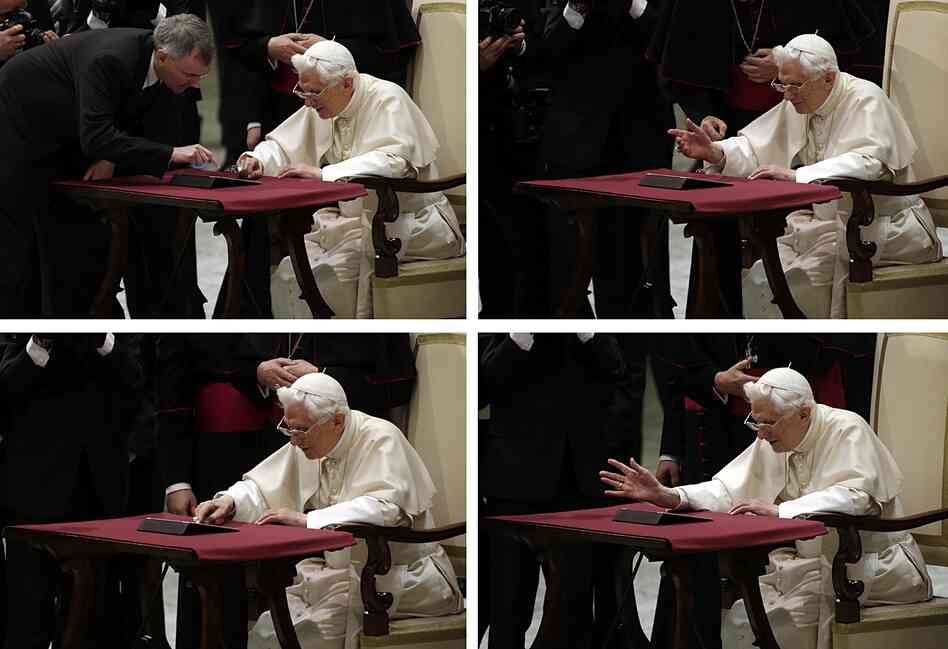 In these images, Pope Benedict XVI pushes the button, with help, to issue the first tweet on his personal account.