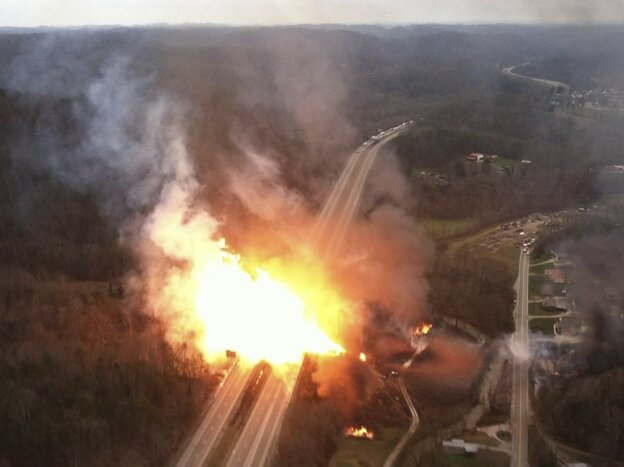 A fireball over Interstate 77 after a gas line ruptured in Sissonville, W. Va. on Tuesday, Dec. 11.
