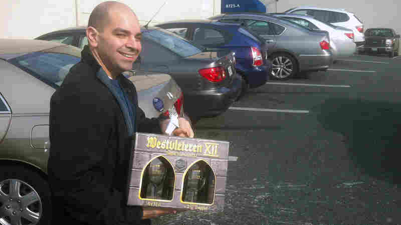 A customer departs Total Wine of Towson, Md., with a gift pack of Belgium's Westvleteren 12 Trappist ale.