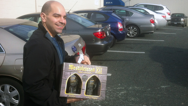 A customer departs Total Wine of Towson, Md., with a gift pack of Belgium's Westvleteren 12 Trappist ale. (NPR)