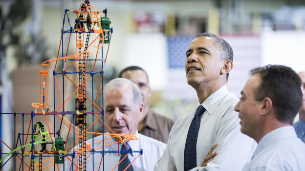 President Obama examines a K'NEX roller coaster on Nov. 30 at a Hatfield, Pa., factory that makes the toys. During the visit, Obama spoke about the economy, the middle class and his plan to raise taxes on top wage earners. (AFP/Getty Images)