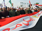 Egyptian clerics from Al-Azhar University hold a national flag as they shout support for President Mohammed Morsi and a new constitution at a rally in Cairo on Dec. 1. Secular and Islamist Egyptians disagree on the constitution, which critics say gives too much power to the clerics of Al-Azhar, the seat of Sunni Islam learning.