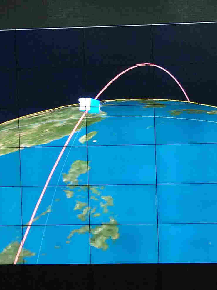 This picture received from North Korea's official Korean Central News Agency on Wednesday shows an orbit image of the satellite Kwangmyongsong-3, being monitored on a large screen at a satellite control center in Cholsan county, North Pyongan province in North Korea.