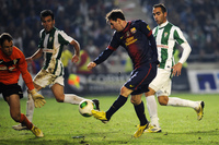Barcelona forward Lionel Messi (in dark blue) shoots on Cordoba's goalkeeper Mikel Saizar (left) during the Spanish Copa del Rey football match in Cordoba on Wednesday.