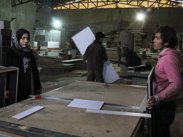 Fatima Jafari, owner of Bamboo Wood Industries, listens to a worker in her factory in Kabul, Afghanistan. Jafari is one of the few female entrepreneurs in an industrial trade in the country, despite international efforts to support women in business.