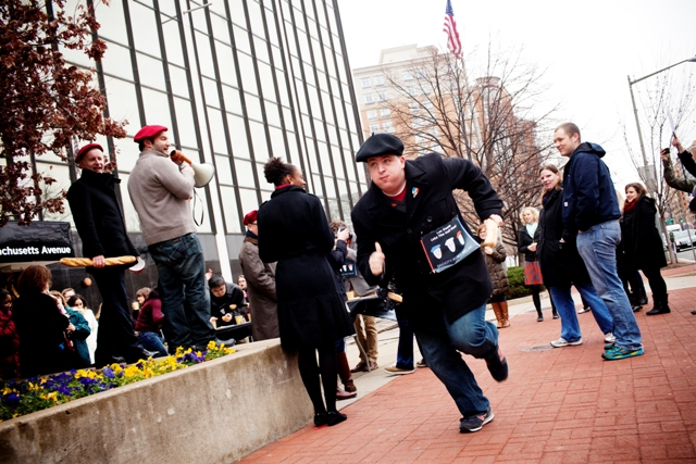 Still chewing his last pastry, Bowers takes off running the first leg of the relay race around NPR Headquarters in DC.