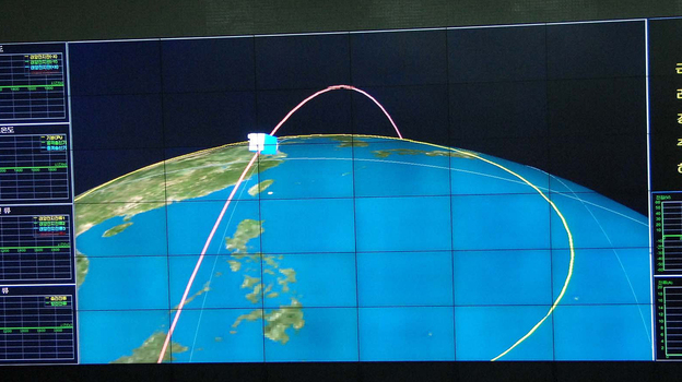 This monitor screen image shows a graphic of the orbit of the satellite carried by the Unha-3 rocket, which North Korea launched this week. The image is from the Korean Central News Agency, distributed in Tokyo by the Korea News Service. (AP)