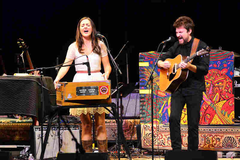 The duo plays a wide range of instruments, including harmonium, banjo and thumb piano.