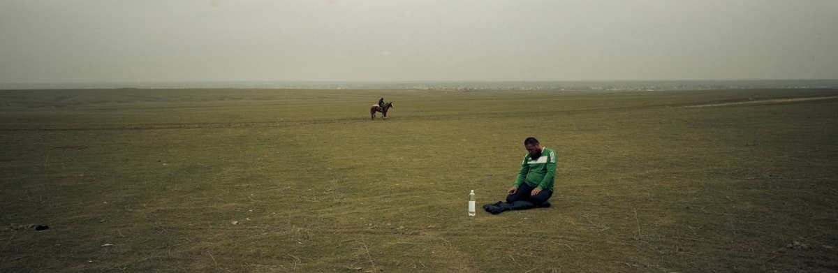 A Kazakh man prays in the steppe near Shymkent in southern Kazakhstan, 2012. The Islamic population has been increasing around Central Asia.