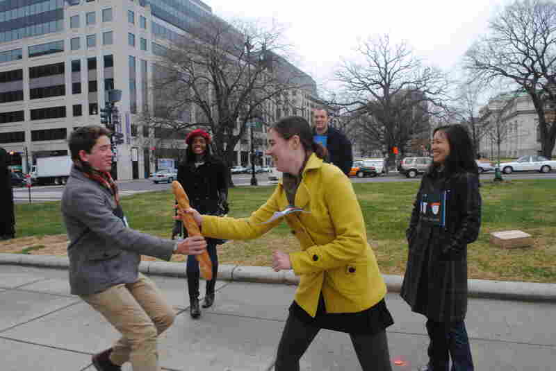 Bard hands off the baguette baton to teammate Emma Roller, an intern on the Washington Desk.