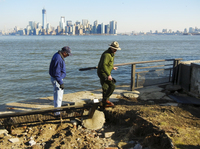 Interior Secretary Ken Salazar (left) and Statue of Liberty National Monument Superintendent David Luchsinger tour flood damage on Liberty Island on Thursday.