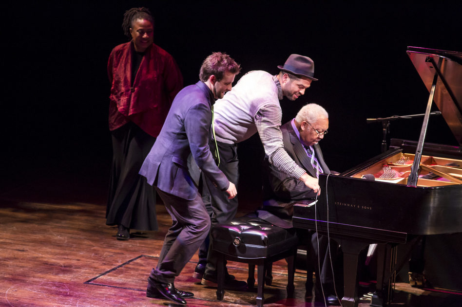 Geri Allen watches as Taylor Eigsti, Jason Moran and Ellis Marsalis, from left, perform in a round robin at <em>A Jazz Piano Christmas 2012</em>.