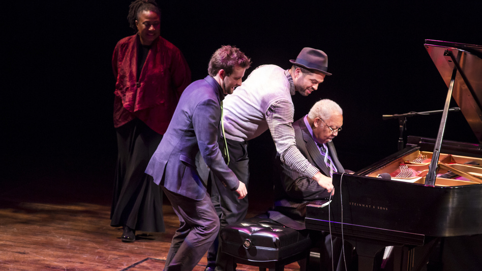 Geri Allen watches as Taylor Eigsti, Jason Moran and Ellis Marsalis, from left, perform in a round robin at A Jazz Piano Christmas 2012. (Brendan Hoffman for NPR)