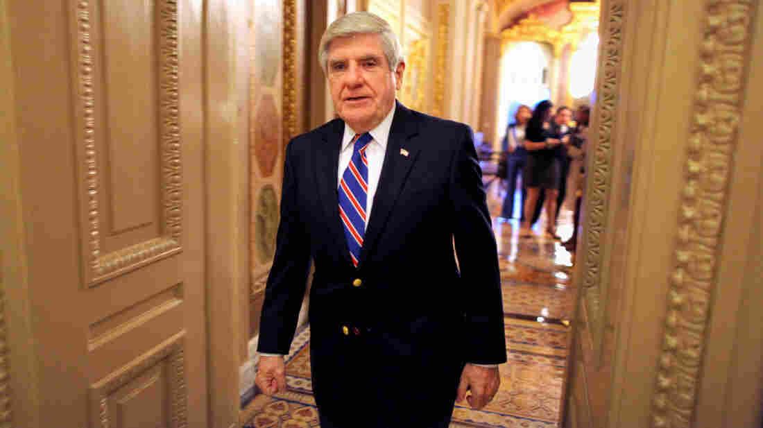 Sen. Ben Nelson, D-Neb., walks off the Senate floor in 2011.