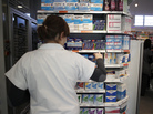 An employee tidies boxes of medicines displayed in a pharmacy in the city of Caen in western France last month. Beginning in 2013, girls between the ages of 15 and 18 will be able to get birth control free of charge, and without parental notification.