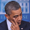 President Obama wipes his eye as he speaks during a press conference at the White House following the shooting in a Connecticut elementary school that left several dead, including children.