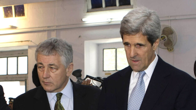 Then-Sen. Chuck Hagel, R-Neb., and Sen. John Kerry, D-Mass., observe voting in parliamentary elections in Lahore, Pakistan, in 2008. President Obama is reportedly considering Hagel as his next defense secretary, and Kerry for secretary of state.