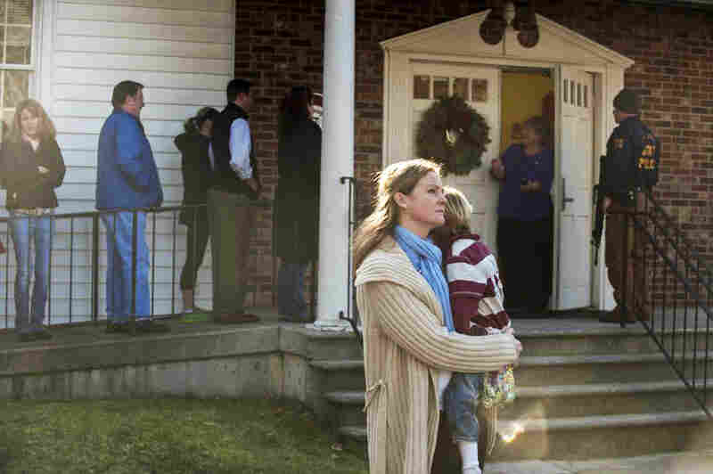 People line up to enter Newtown Methodist Church, near the site of Friday's shooting.