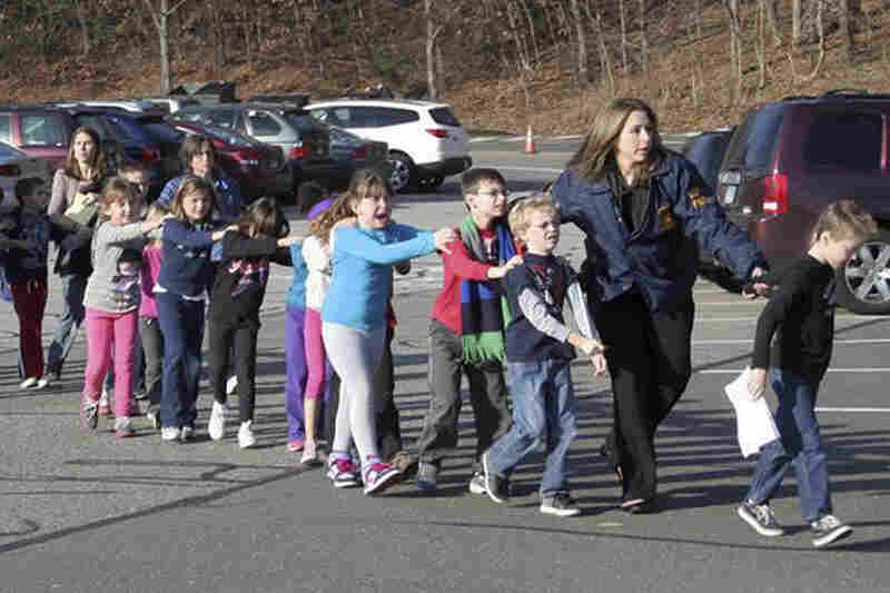 Connecticut State Police lead children from Sandy Hook Elementary.
