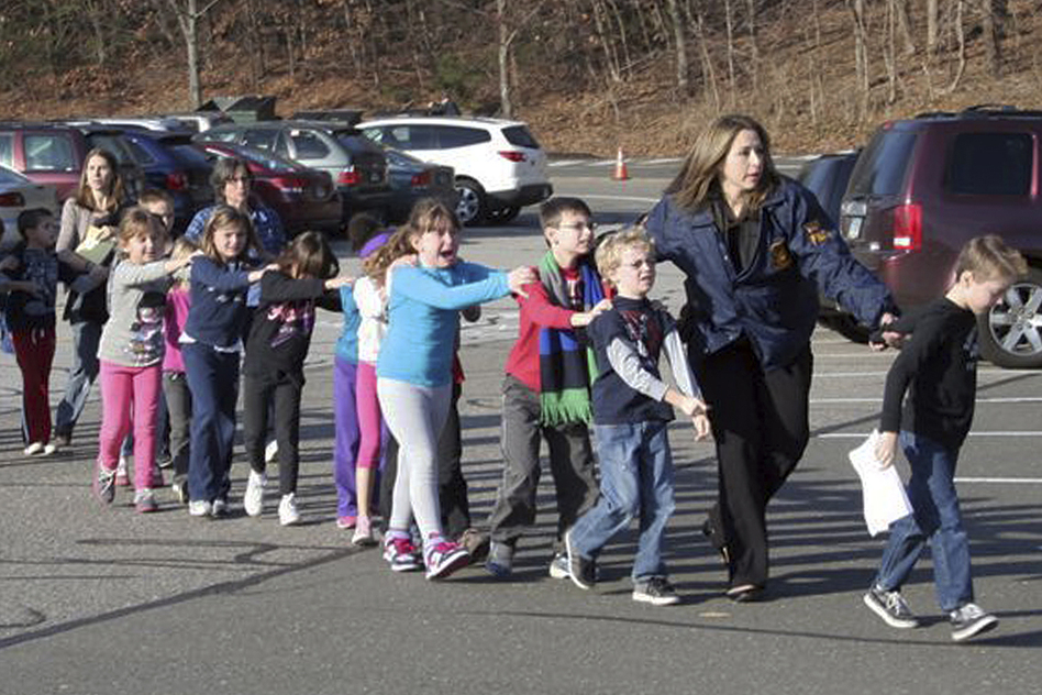 Connecticut State Police lead children from Sandy Hook Elementary. (AP)