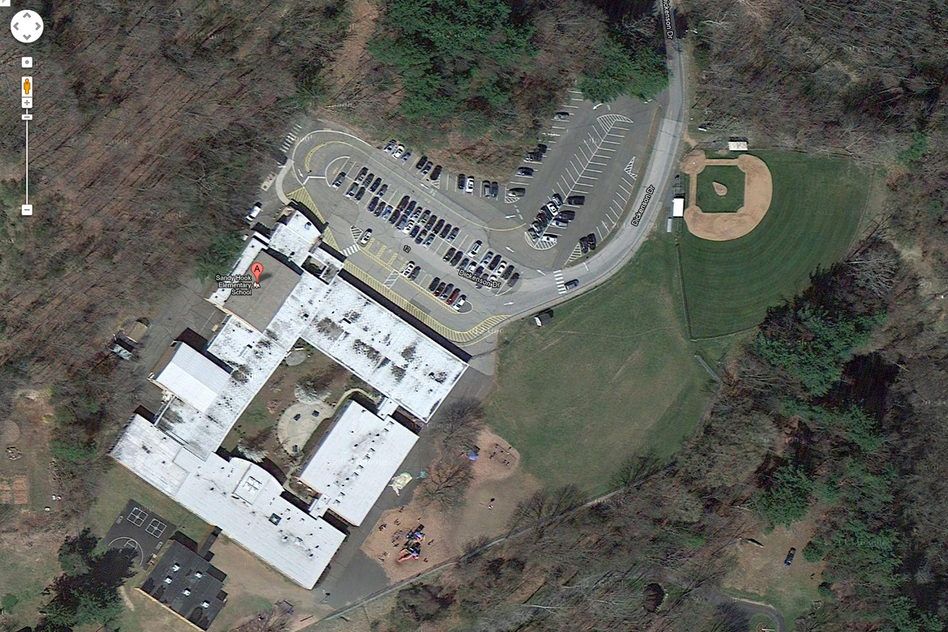 This satellite image provided by Google shows an aerial view of Sandy Hook Elementary School. (AP)