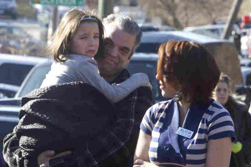 Parents pick up their children outside Sandy Hook Elementary School.