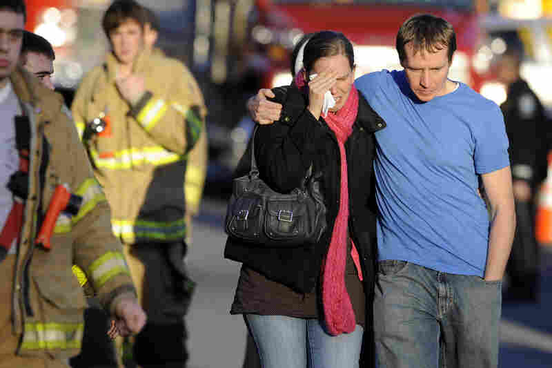 Family members leave a firehouse staging area after the shooting in Newtown.