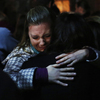 People grieve outside the overflow area of a vigil at the Saint Rose of Lima church in Newtown, Conn., on Friday following the mass shooting at the Sandy Hook Elementary School.