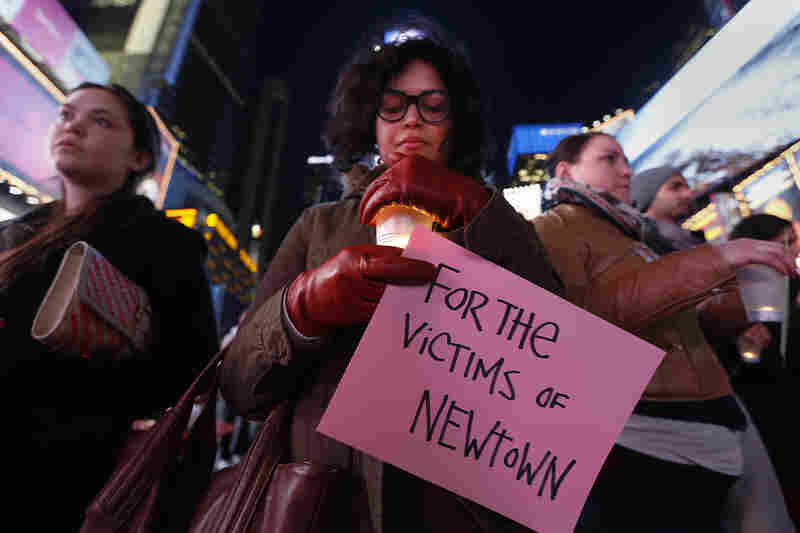 Farah Sheikh takes part in a candlelight vigil in Times Square, for the victims of the Sandy Hook Elementary School shooting, in New York City.