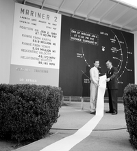 Scientists show off reams of data collected by Mariner 2 as it passed by Venus. The probe flew by the planet on Dec. 14, 1962, and scanned the surface for 42 minutes.