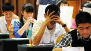 Argh, it's on the tip of my tongue! Contestants in the Names and Faces competition focus at last year's World Memory Championships held in Guangzhou, China. A new field of mental athletes is currently vying for the 2012 championship.