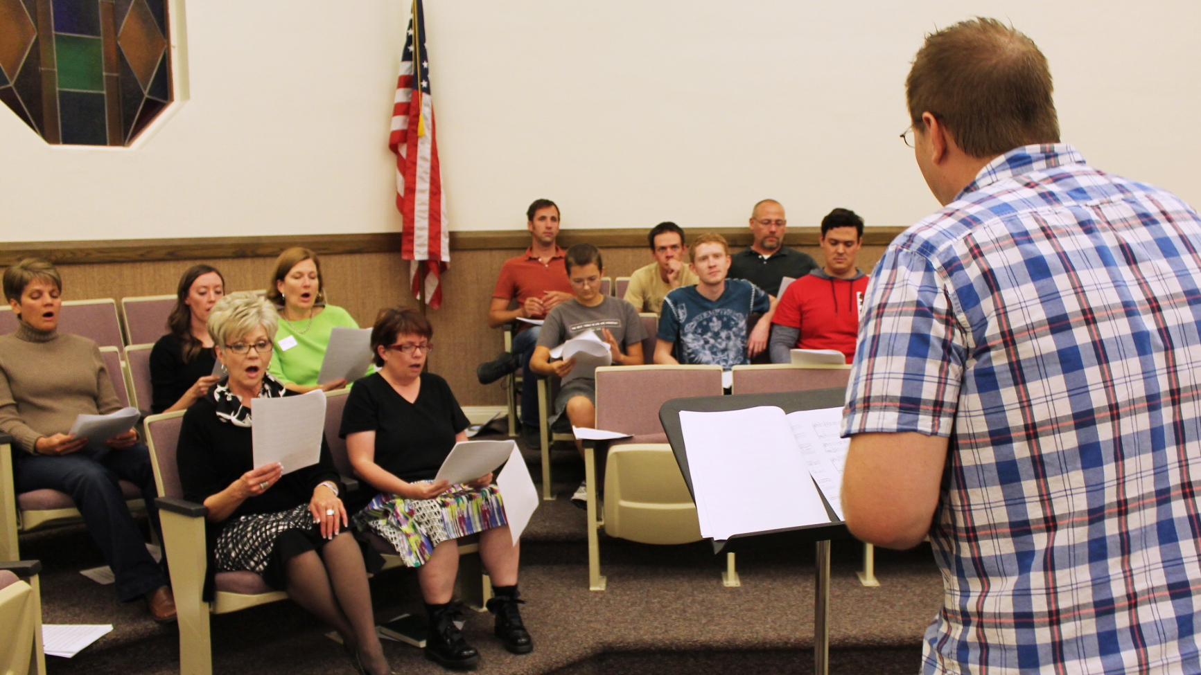 The choir's musical director, Bryan Horn, leads the ensemble in rehearsal.